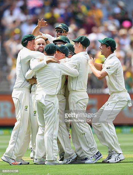 Nathan Lyon of Australia is congratulated by team mates after getting the wicket of Sami Aslam of Pakistan during day one of the Second Test match...