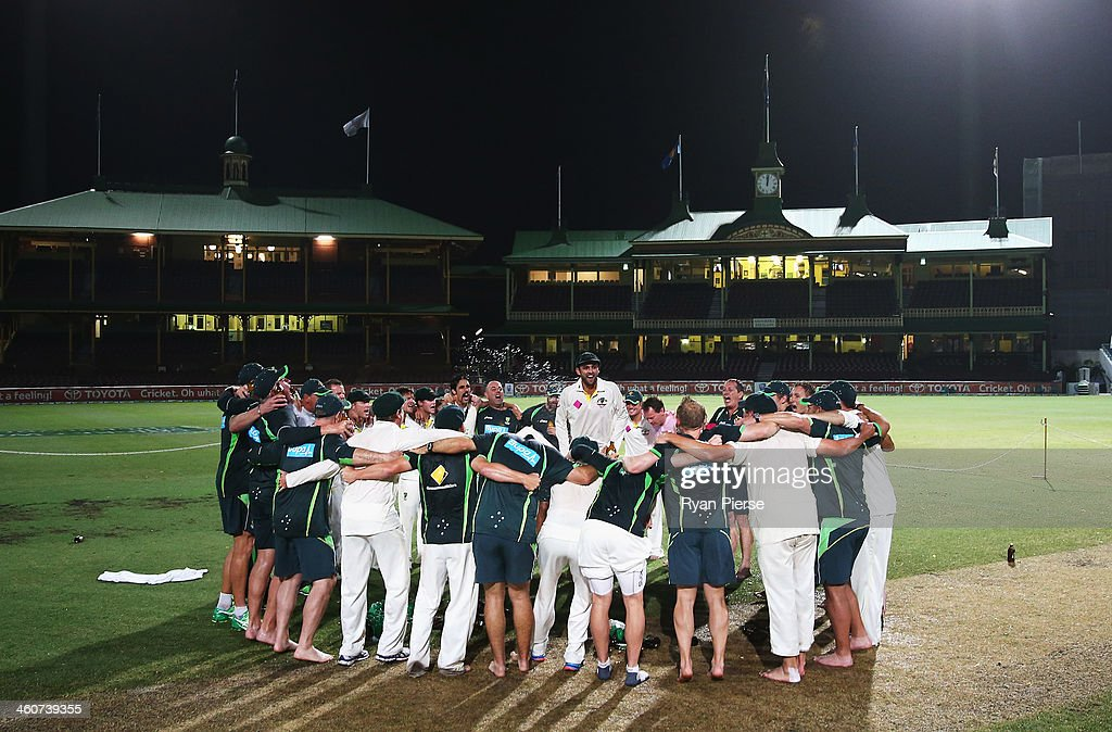 Nathan Lyon of Australia leads the team song on the pitch at midnight after day three of the Fifth Ashes Test match between Australia and England at Sydney Cricket Ground on January 5, 2014 in Sydney, Australia.