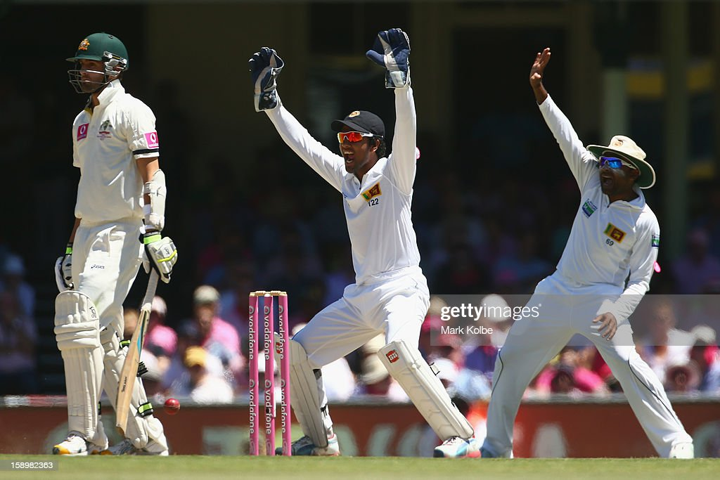 Nathan Lyon of Australia looks at the umpire as Dinesh Chandimal and Mahela Jayawardene of Sri Lanka appeal during day three of the Third Test match between Australia and Sri Lanka at Sydney Cricket Ground on January 5, 2013 in Sydney, Australia.