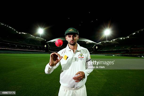 Nathan Lyon of Australia poses for a photograph under lights after an Australian nets session at the Adelaide Oval on November 25 2015 in Adelaide...