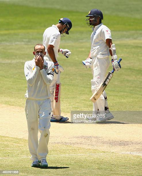 Nathan Lyon of Australia reacts after an appeal for the wicket of Virat Kohli of India was turned down during day five of the First Test match...