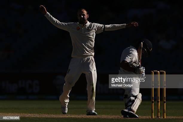 Nathan Lyon of Australia reacts after having an LBW appeal turned down against Virat Kohli of India during day three of the First Test match between...