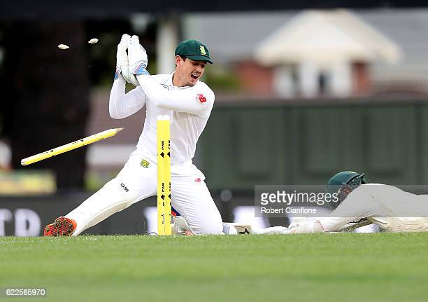 Nathan Lyon of Australia survives a run out attempt from Quinton de Kock of South Africa during day one of the Second Test match between Australia...