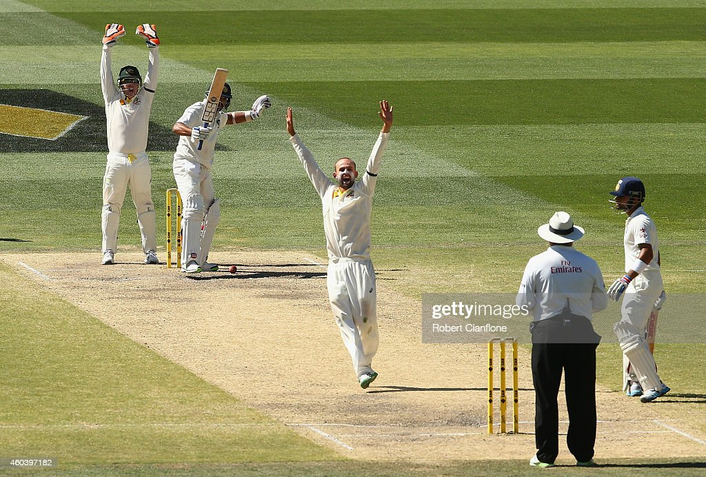 <a gi-track='captionPersonalityLinkClicked' href=/galleries/search?phrase=Nathan+Lyon+-+Cricketer&family=editorial&specificpeople=11072184 ng-click='$event.stopPropagation()'>Nathan Lyon</a> of Australia taakes the wicket of <a gi-track='captionPersonalityLinkClicked' href=/galleries/search?phrase=Murali+Vijay&family=editorial&specificpeople=5592328 ng-click='$event.stopPropagation()'>Murali Vijay</a> of India during day five of the First Test match between Australia and India at Adelaide Oval on December 13, 2014 in Adelaide, Australia.