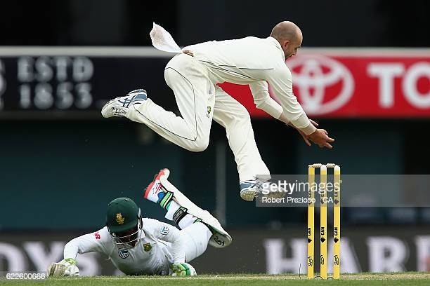 Nathan Lyon of Australia unsuccessfully attempts to run out Temba Bavuma of South Africa during day one of the Second Test match between Australia...