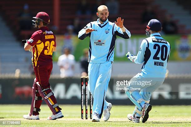Nathan Lyon of the Blues celebrates with team mate Peter Nevill after claiming the wicket of Ben Cutting of the Bulls during the Matador BBQs One Day...
