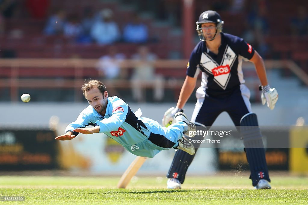 Nathan Lyon of the Blues dives to save a run during the Ryobi Cup match between the New South Wales Blues and the Victorian Bushrangers at North Sydney Oval on October 20, 2013 in Sydney, Australia.