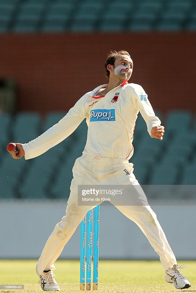 Nathan Lyon of the Redbacks bowls during day one of the Sheffield Shield match between the South Australia Redbacks and the Victoria Bushrangers at Adelaide Oval on January 24, 2013 in Adelaide, Australia.