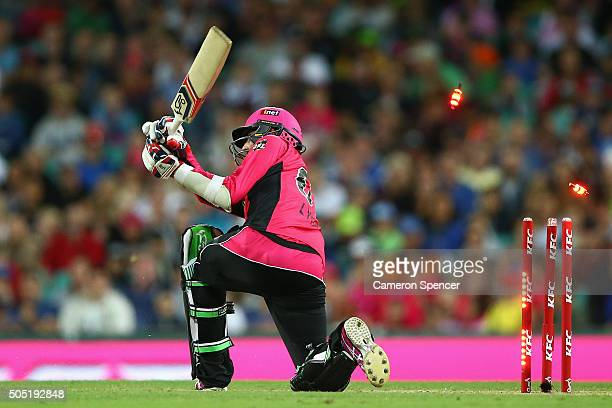 Nathan Lyon of the Sixers is bowled by Chris Green of the Thunder during the Big Bash League match between the Sydney Sixers and the Sydney Thunder...
