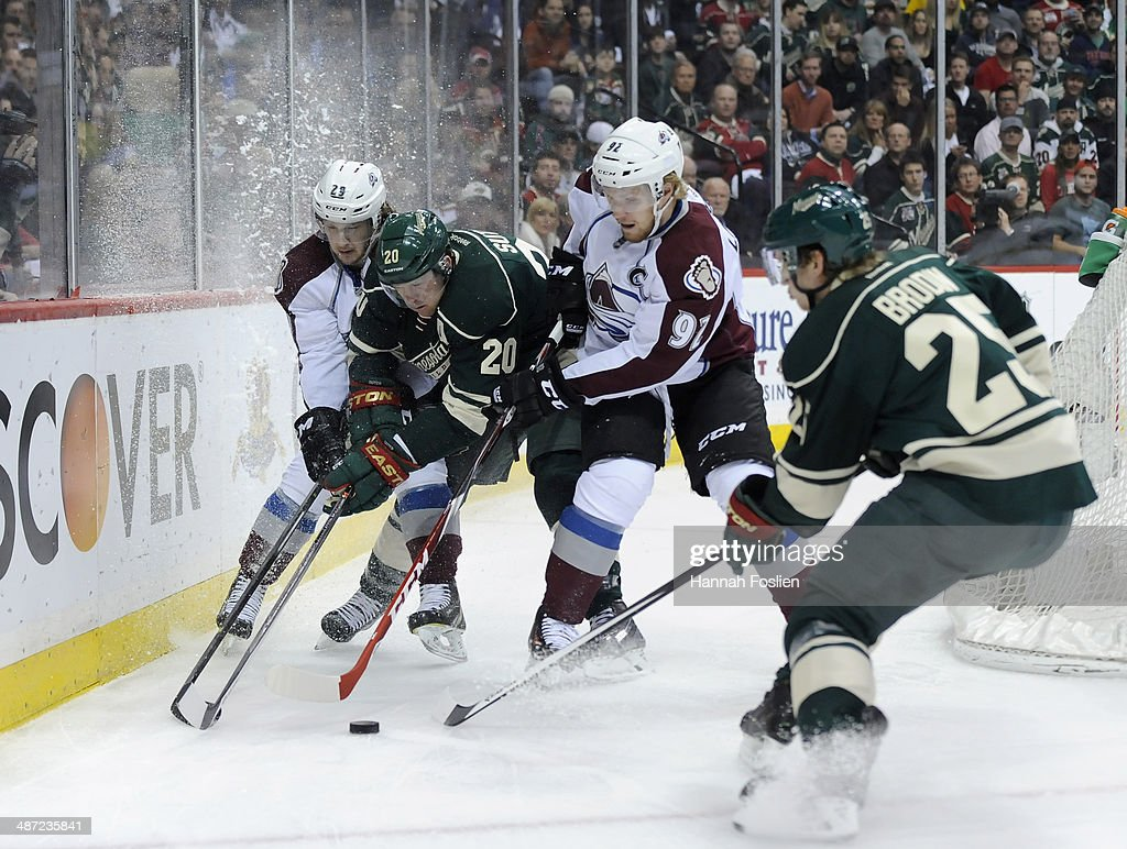 Nathan MacKinnon #29 and Gabriel Landeskog #92 of the Colorado Avalanche skate after the puck along with Ryan Suter #20 and Jonas Brodin #25 of the Minnesota Wild during the first period in Game Six of the First Round of the 2014 NHL Stanley Cup Playoffs on April 28, 2014 at Xcel Energy Center in St Paul, Minnesota.
