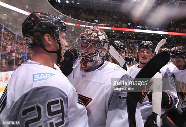 Nathan MacKinnon and John Gibson of Team North America celebrate after a 43 overtime win over Team Sweden during the World Cup of Hockey 2016 at Air...