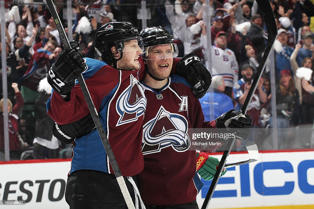 Nathan MacKinnon #29 and Paul Stastny #26 of the Colorado Avalanche celebrate an open net goal late in the third period against the Minnesota Wild in Game Two of the First Round of the 2014 Stanley Cup Playoffs at the Pepsi Center on April 19, 2014 in Denver, Colorado. The Avalanche defeated the Wild 4-2.