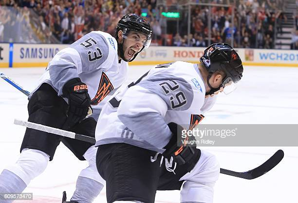 Nathan MacKinnon celebrates with Shayne Gostisbehere of Team North America after scoring an overtime goal on Team Sweden during the World Cup of...