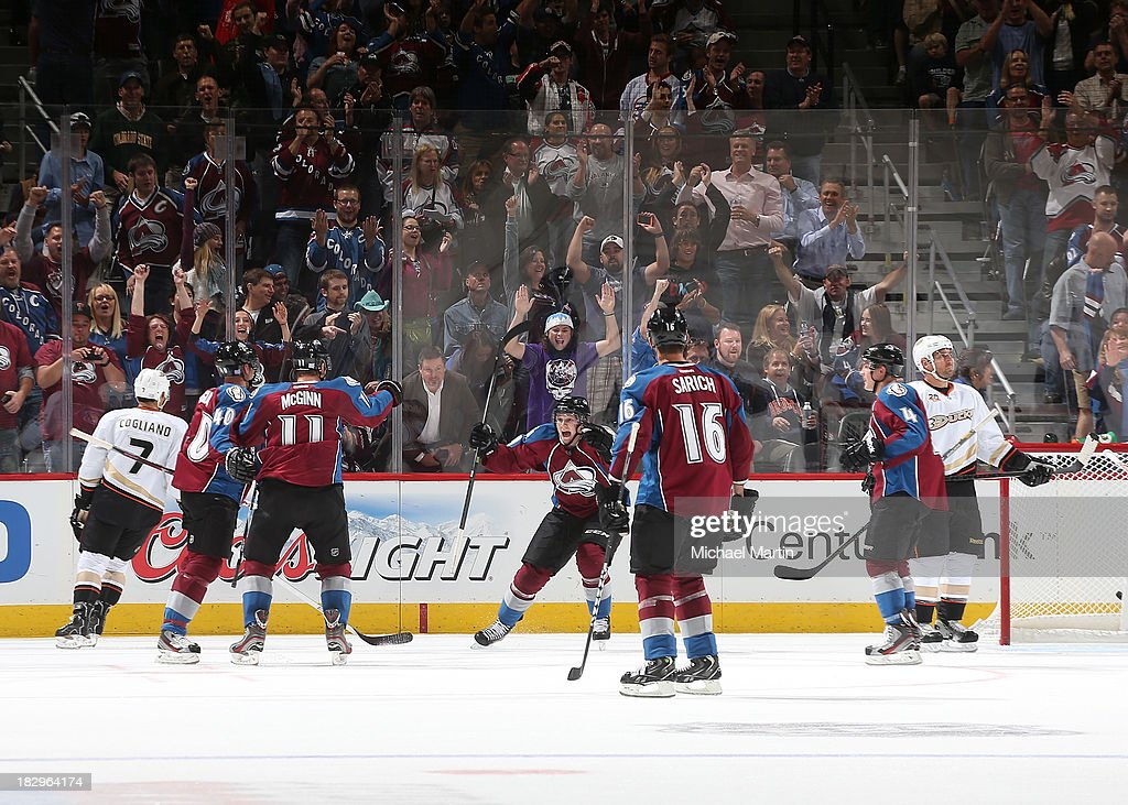 <a gi-track='captionPersonalityLinkClicked' href=/galleries/search?phrase=Nathan+MacKinnon&family=editorial&specificpeople=8610127 ng-click='$event.stopPropagation()'>Nathan MacKinnon</a> # 29 gets his first assist in the NHL when John Mitchell #7 of the Colorado Avalanche scores against the Anaheim Ducks at the Pepsi Center on October 2, 2013 in Denver, Colorado.