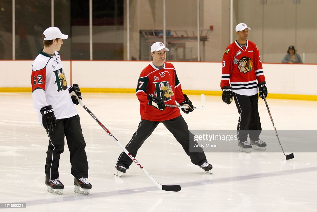 <a gi-track='captionPersonalityLinkClicked' href=/galleries/search?phrase=Nathan+MacKinnon&family=editorial&specificpeople=8610127 ng-click='$event.stopPropagation()'>Nathan MacKinnon</a>, Jonathan Drouin and Seth Jones skate during the 2013 NHL Draft - Top Prospects Clinic at Prudential Center on June 29, 2013 in Newark, New Jersey.