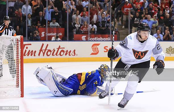 Nathan MacKinnon of Team North America celebrates after scoring an overtime goal on Henrik Lundqvist of Team Sweden during the World Cup of Hockey...