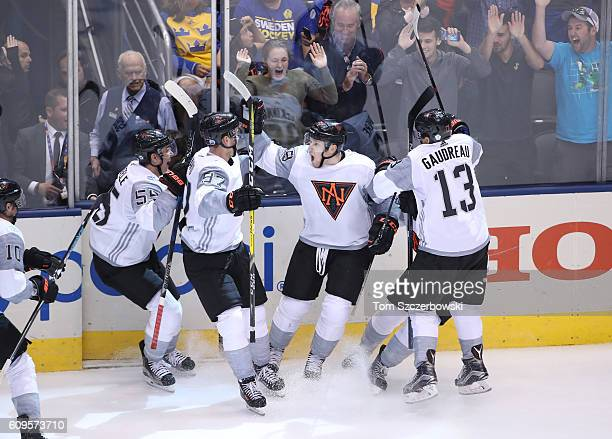 Nathan MacKinnon of Team North America celebrates his gamewinning goal in overtime against Team Sweden during the World Cup of Hockey tournament at...