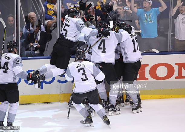 Nathan MacKinnon of Team North America is congratulated by teammates after scoring a gamewinning goal in overtime against Team Sweden during the...
