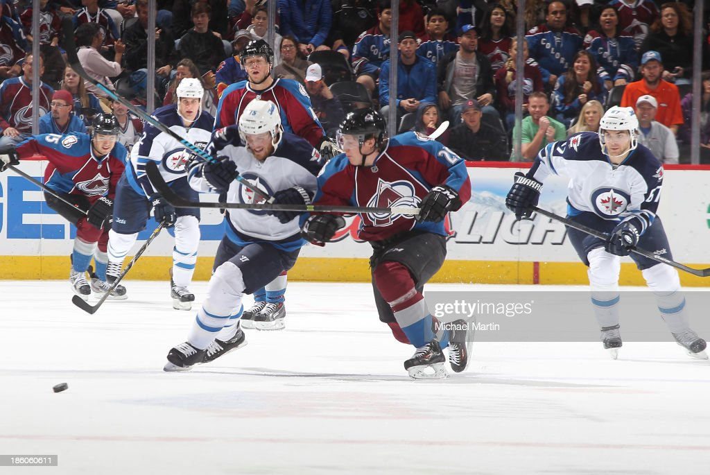 <a gi-track='captionPersonalityLinkClicked' href=/galleries/search?phrase=Nathan+MacKinnon&family=editorial&specificpeople=8610127 ng-click='$event.stopPropagation()'>Nathan MacKinnon</a> #29 of the Colorado Avalanche and <a gi-track='captionPersonalityLinkClicked' href=/galleries/search?phrase=Matt+Halischuk&family=editorial&specificpeople=714406 ng-click='$event.stopPropagation()'>Matt Halischuk</a> #15 of the Winnipeg Jets battle for the puck at the Pepsi Center on October 27, 2013 in Denver, Colorado.