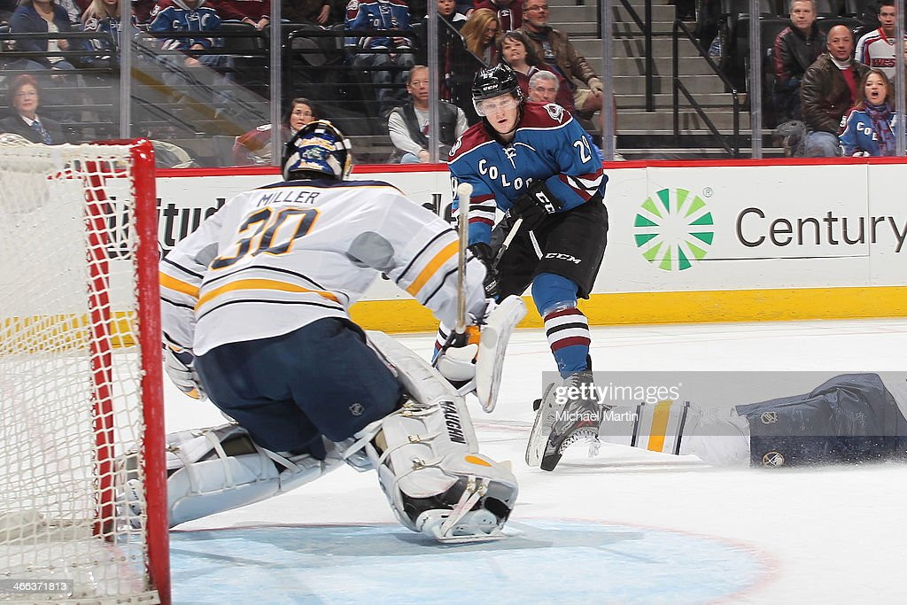 Nathan MacKinnon #29 of the Colorado Avalanche assists teammate Gabriel Landeskog #92 on a first period goal against goaltender Ryan Miller #30 of the Buffalo Sabres at the Pepsi Center on February 1, 2014 in Denver, Colorado.