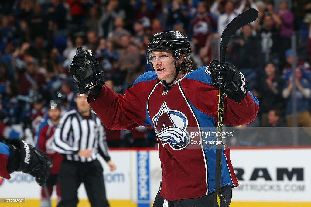 <a gi-track='captionPersonalityLinkClicked' href=/galleries/search?phrase=Nathan+MacKinnon&family=editorial&specificpeople=8610127 ng-click='$event.stopPropagation()'>Nathan MacKinnon</a> #29 of the Colorado Avalanche celebrates a second-period goal by teammate John Mitchell (not pictured) to take a 1-0 lead over the Winnipeg Jets at Pepsi Center on March 10, 2014 in Denver, Colorado.