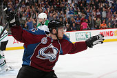 Nathan MacKinnon of the Colorado Avalanche celebrates after scoring a goal against the Dallas Stars at the Pepsi Center on October 10 2015 in Denver...