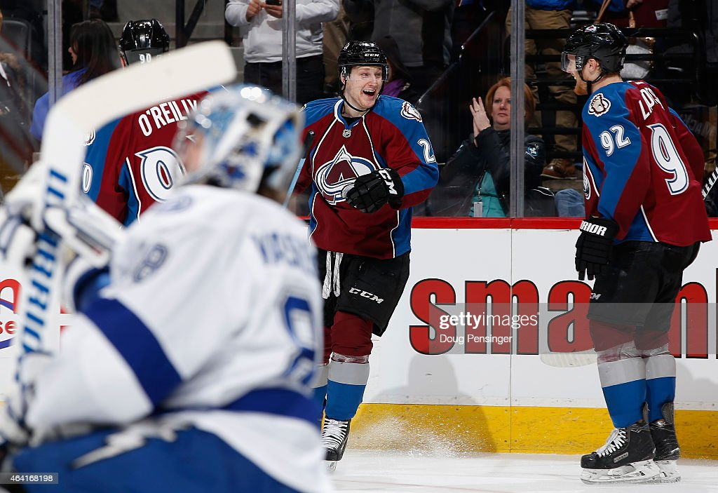 <a gi-track='captionPersonalityLinkClicked' href=/galleries/search?phrase=Nathan+MacKinnon&family=editorial&specificpeople=8610127 ng-click='$event.stopPropagation()'>Nathan MacKinnon</a> #29 of the Colorado Avalanche celebrates his third goal of the game against goalie <a gi-track='captionPersonalityLinkClicked' href=/galleries/search?phrase=Andrei+Vasilevskiy+-+Ice+Hockey+Player&family=editorial&specificpeople=9594320 ng-click='$event.stopPropagation()'>Andrei Vasilevskiy</a> #88 of the Tampa Bay Lightning with teammates <a gi-track='captionPersonalityLinkClicked' href=/galleries/search?phrase=Ryan+O%27Reilly&family=editorial&specificpeople=4754037 ng-click='$event.stopPropagation()'>Ryan O'Reilly</a> #90 and <a gi-track='captionPersonalityLinkClicked' href=/galleries/search?phrase=Gabriel+Landeskog&family=editorial&specificpeople=6590816 ng-click='$event.stopPropagation()'>Gabriel Landeskog</a> #92 of the Colorado Avalanche as his hat trick gave the Avalanche a 4-2 in the second period at Pepsi Center on February 22, 2015 in Denver, Colorado.