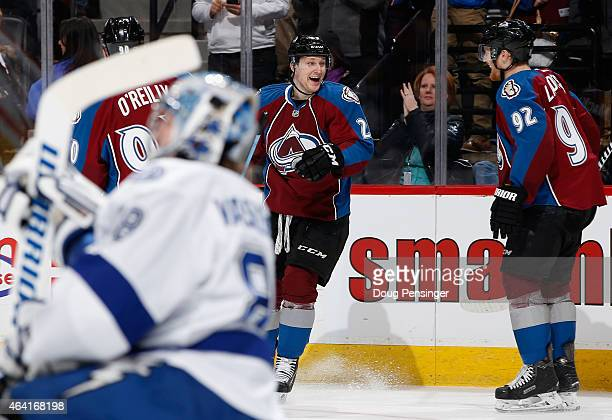 Nathan MacKinnon of the Colorado Avalanche celebrates his third goal of the game against goalie Andrei Vasilevskiy of the Tampa Bay Lightning with...