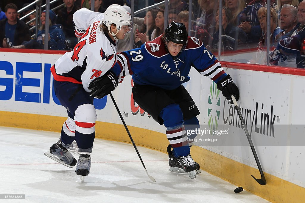 <a gi-track='captionPersonalityLinkClicked' href=/galleries/search?phrase=Nathan+MacKinnon&family=editorial&specificpeople=8610127 ng-click='$event.stopPropagation()'>Nathan MacKinnon</a> #29 of the Colorado Avalanche controls the puck against John Carlson #74 of the Washington Capitals at Pepsi Center on November 10, 2013 in Denver, Colorado. The Avalanche defeated the Capitals 4-1.