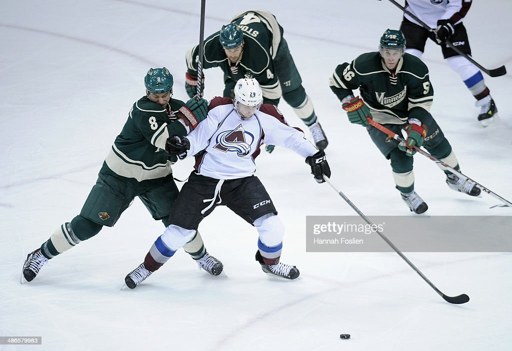 <a gi-track='captionPersonalityLinkClicked' href=/galleries/search?phrase=Nathan+MacKinnon&family=editorial&specificpeople=8610127 ng-click='$event.stopPropagation()'>Nathan MacKinnon</a> #29 of the Colorado Avalanche controls the puck against <a gi-track='captionPersonalityLinkClicked' href=/galleries/search?phrase=Cody+McCormick&family=editorial&specificpeople=213546 ng-click='$event.stopPropagation()'>Cody McCormick</a> #8, <a gi-track='captionPersonalityLinkClicked' href=/galleries/search?phrase=Clayton+Stoner&family=editorial&specificpeople=2222214 ng-click='$event.stopPropagation()'>Clayton Stoner</a> #4 and <a gi-track='captionPersonalityLinkClicked' href=/galleries/search?phrase=Erik+Haula&family=editorial&specificpeople=5894652 ng-click='$event.stopPropagation()'>Erik Haula</a> #56 of the Minnesota Wild during the second period in Game Four of the First Round of the 2014 NHL Stanley Cup Playoffs on April 24, 2014 at Xcel Energy Center in St Paul, Minnesota. The Wild defeated the Avalanche 2-1.