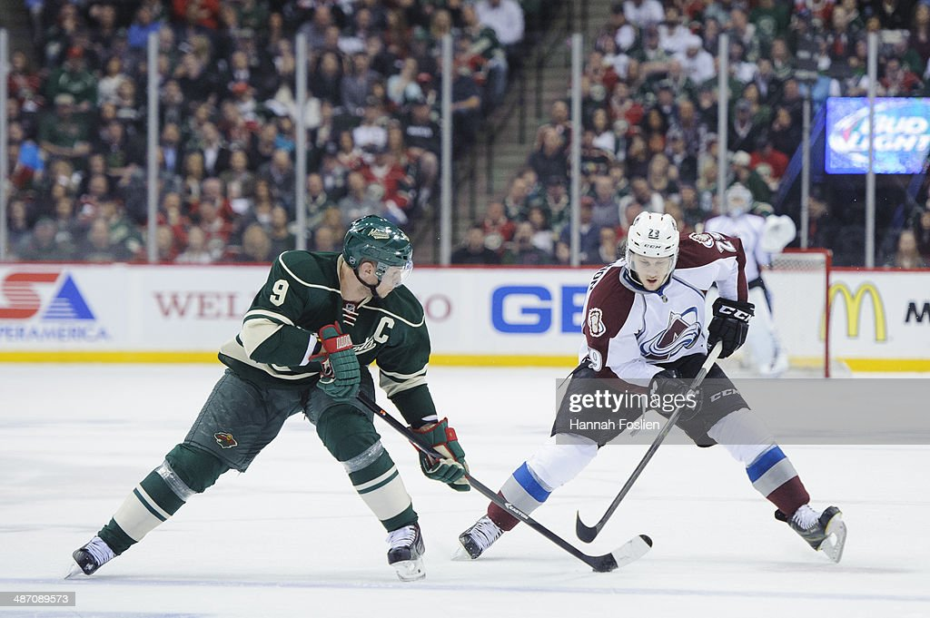 <a gi-track='captionPersonalityLinkClicked' href=/galleries/search?phrase=Nathan+MacKinnon&family=editorial&specificpeople=8610127 ng-click='$event.stopPropagation()'>Nathan MacKinnon</a> #29 of the Colorado Avalanche controls the puck against <a gi-track='captionPersonalityLinkClicked' href=/galleries/search?phrase=Mikko+Koivu&family=editorial&specificpeople=584987 ng-click='$event.stopPropagation()'>Mikko Koivu</a> #9 of the Minnesota Wild in Game Three of the First Round of the 2014 NHL Stanley Cup Playoffs on April 21, 2014 at Xcel Energy Center in St Paul, Minnesota.