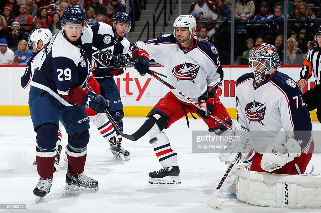 <a gi-track='captionPersonalityLinkClicked' href=/galleries/search?phrase=Nathan+MacKinnon&family=editorial&specificpeople=8610127 ng-click='$event.stopPropagation()'>Nathan MacKinnon</a> #29 of the Colorado Avalanche has his stick broken by the puck as he tries to redirect a shot as goalie <a gi-track='captionPersonalityLinkClicked' href=/galleries/search?phrase=Sergei+Bobrovsky&family=editorial&specificpeople=4488556 ng-click='$event.stopPropagation()'>Sergei Bobrovsky</a> #72 of the Columbus Blue Jackets defends the goal at Pepsi Center on October 24, 2015 in Denver, Colorado.