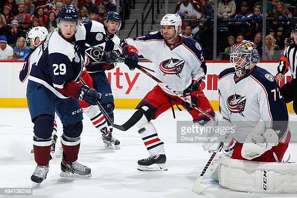 Nathan MacKinnon of the Colorado Avalanche has his stick broken by the puck as he tries to redirect a shot as goalie Sergei Bobrovsky of the Columbus...