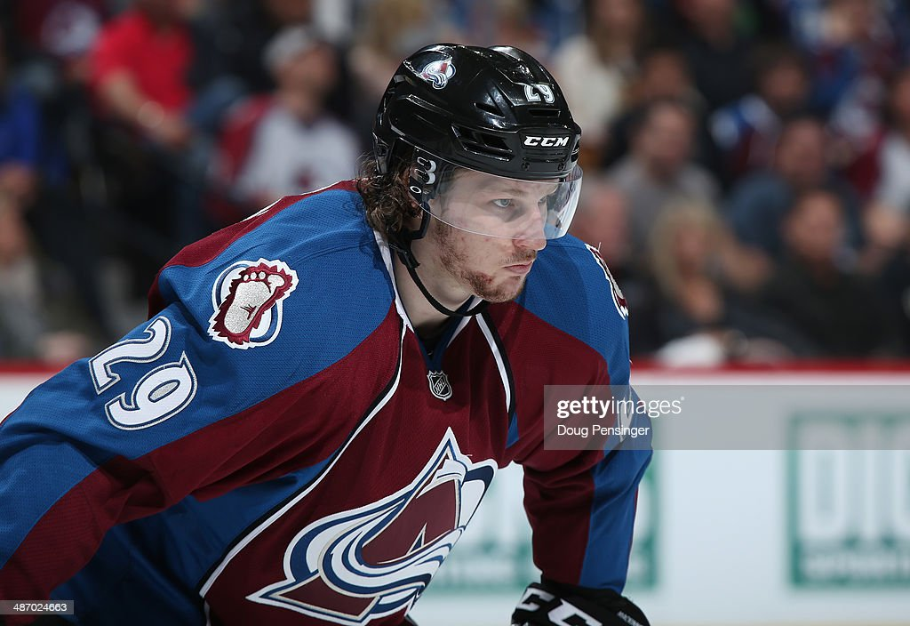 <a gi-track='captionPersonalityLinkClicked' href=/galleries/search?phrase=Nathan+MacKinnon&family=editorial&specificpeople=8610127 ng-click='$event.stopPropagation()'>Nathan MacKinnon</a> #29 of the Colorado Avalanche looks on during a break in the action as he went on to score the game winning goal against the Minnesota Wild Game Five of the First Round of the 2014 NHL Stanley Cup Playoffs at Pepsi Center on April 26, 2014 in Denver, Colorado. The Avalanche defeated the Wild 4-3 in overtime to take a 3-2 game lead in the series.