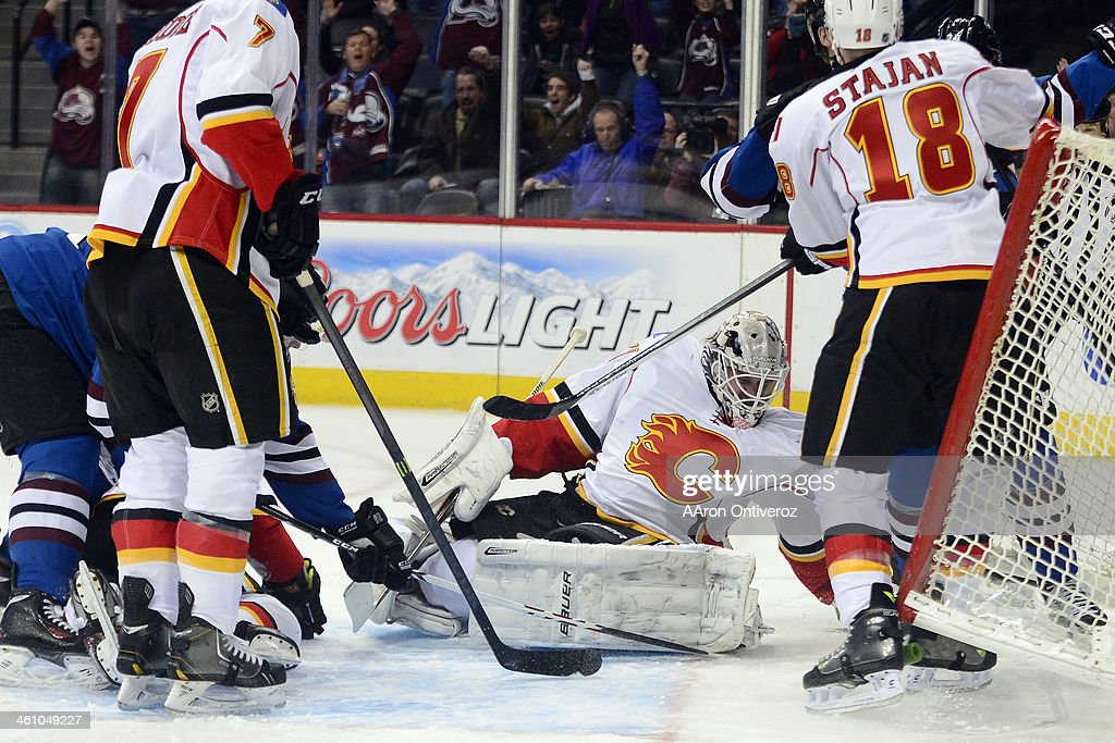 Nathan MacKinnon (29) of the Colorado Avalanche makes a shot on Karri Ramo (31) of the Calgary Flames -- the first of two goals for the rookie -- during the first period of action. The Colorado Avalanche hosted the Calgary Flames at the Pepsi Center on January 06, 2014.