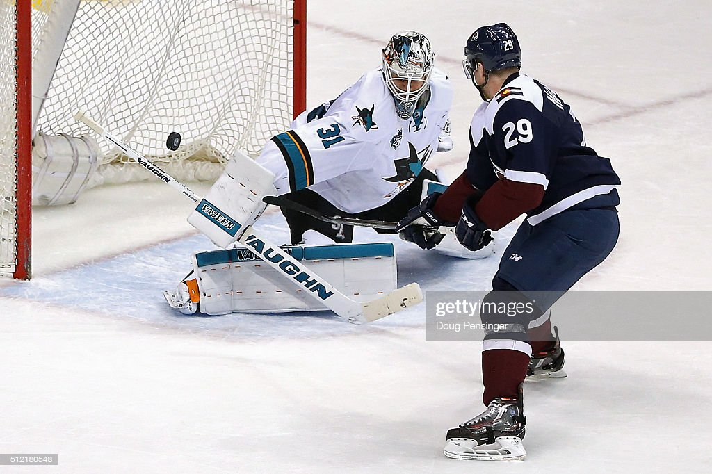 <a gi-track='captionPersonalityLinkClicked' href=/galleries/search?phrase=Nathan+MacKinnon&family=editorial&specificpeople=8610127 ng-click='$event.stopPropagation()'>Nathan MacKinnon</a> #29 of the Colorado Avalanche puts the puck past goalie <a gi-track='captionPersonalityLinkClicked' href=/galleries/search?phrase=Martin+Jones+-+Ice+Hockey+Player&family=editorial&specificpeople=12318960 ng-click='$event.stopPropagation()'>Martin Jones</a> #31 of the San Jose Sharks for a goal in the overtime shoot out at Pepsi Center on February 24, 2016 in Denver, Colorado. The Avalanche defeated the Sharks 4-3 in an overtime shoot out.