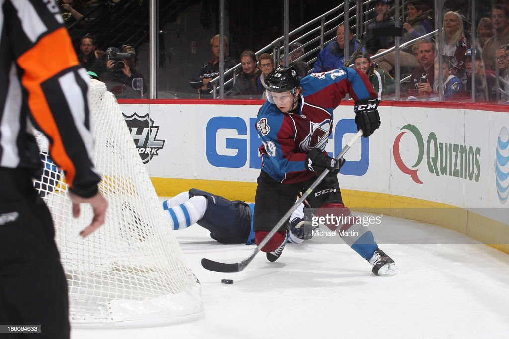 <a gi-track='captionPersonalityLinkClicked' href=/galleries/search?phrase=Nathan+MacKinnon&family=editorial&specificpeople=8610127 ng-click='$event.stopPropagation()'>Nathan MacKinnon</a> #29 of the Colorado Avalanche skates against the Winnipeg Jets at the Pepsi Center on October 27, 2013 in Denver, Colorado. The Avalanche defeated the Jets 3-2.