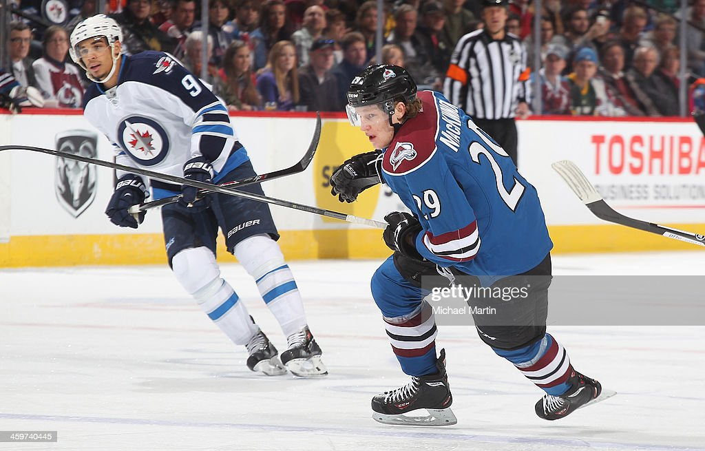 <a gi-track='captionPersonalityLinkClicked' href=/galleries/search?phrase=Nathan+MacKinnon&family=editorial&specificpeople=8610127 ng-click='$event.stopPropagation()'>Nathan MacKinnon</a> #29 of the Colorado Avalanche skates against the Winnipeg Jets at the Pepsi Center on December 29, 2013 in Denver, Colorado.