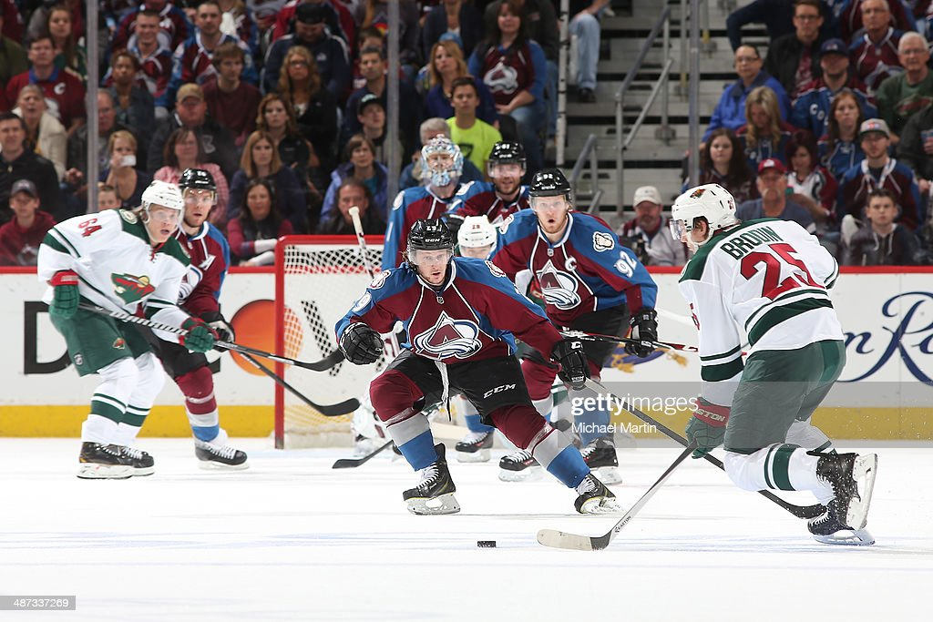 Nathan MacKinnon #29 of the Colorado Avalanche skates into position to defend against Jonas Brodin #25 of the Minnesota Wild in Game Five of the First Round of the 2014 Stanley Cup Playoffs at the Pepsi Center on April 26, 2014 in Denver, Colorado.