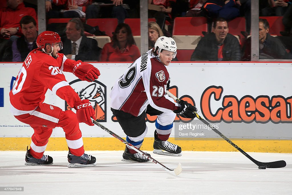 <a gi-track='captionPersonalityLinkClicked' href=/galleries/search?phrase=Nathan+MacKinnon&family=editorial&specificpeople=8610127 ng-click='$event.stopPropagation()'>Nathan MacKinnon</a> #29 of the Colorado Avalanche skates with the puck as Drew Miller #20 of the Detroit Red Wings defends during an NHL game on March 6, 2014 at Joe Louis Arena in Detroit, Michigan. Colorado defeated Detroit 3-2 in overtime.