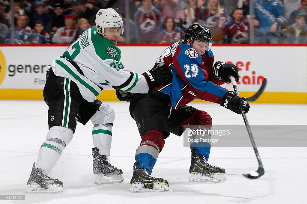 <a gi-track='captionPersonalityLinkClicked' href=/galleries/search?phrase=Nathan+MacKinnon&family=editorial&specificpeople=8610127 ng-click='$event.stopPropagation()'>Nathan MacKinnon</a> #29 of the Colorado Avalanche takes a shot as <a gi-track='captionPersonalityLinkClicked' href=/galleries/search?phrase=Colton+Sceviour&family=editorial&specificpeople=5591419 ng-click='$event.stopPropagation()'>Colton Sceviour</a> #22 of the Dallas Stars defends at Pepsi Center on January 10, 2015 in Denver, Colorado.