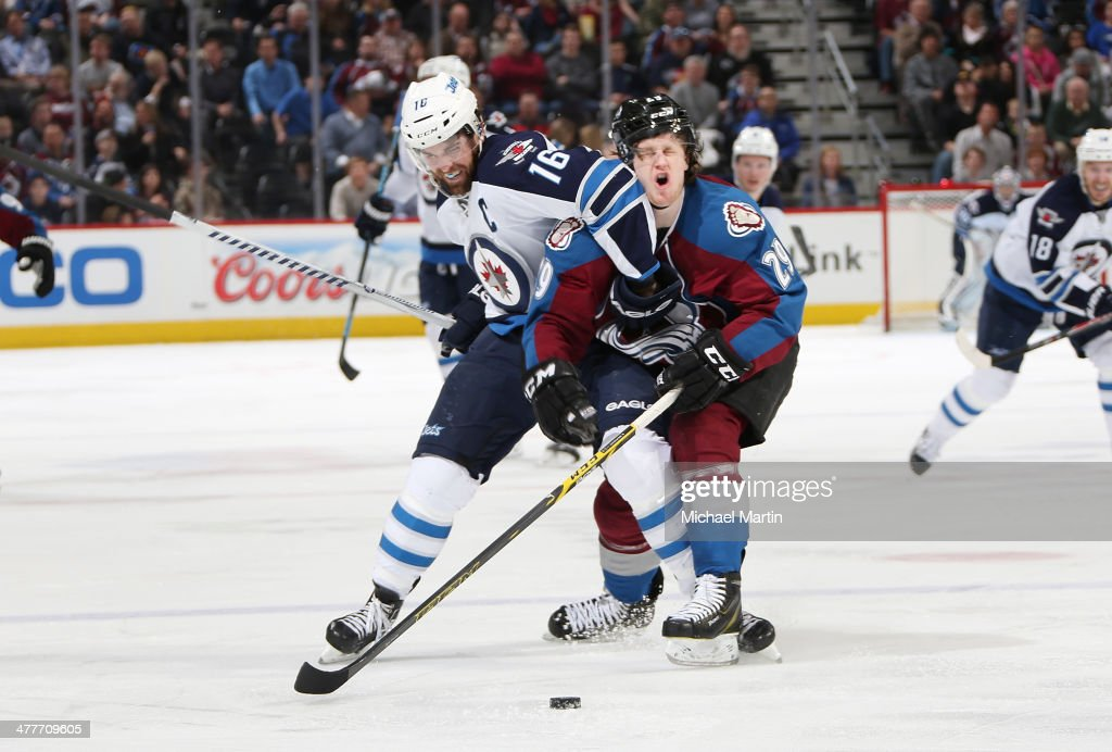 <a gi-track='captionPersonalityLinkClicked' href=/galleries/search?phrase=Nathan+MacKinnon&family=editorial&specificpeople=8610127 ng-click='$event.stopPropagation()'>Nathan MacKinnon</a> #29 of the Colorado Avalanche takes an elbow to the face from <a gi-track='captionPersonalityLinkClicked' href=/galleries/search?phrase=Andrew+Ladd&family=editorial&specificpeople=228452 ng-click='$event.stopPropagation()'>Andrew Ladd</a> #16 of the Winnipeg Jets at the Pepsi Center on March 10, 2014 in Denver, Colorado.