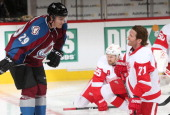 Nathan MacKinnon of the Colorado Avalanche talks with Daniel Cleary of the Detroit Red Wings prior to the game at the Pepsi Center on October 17 2013...