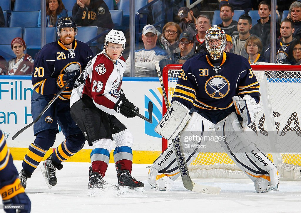 Nathan MacKinnon #29 of the Colorado Avalanche tries to get position in front of the net defended by Henrik Tallinder #20 and Ryan Miller #30 of the Buffalo Sabres on October 19, 2013 at the First Niagara Center in Buffalo, New York.