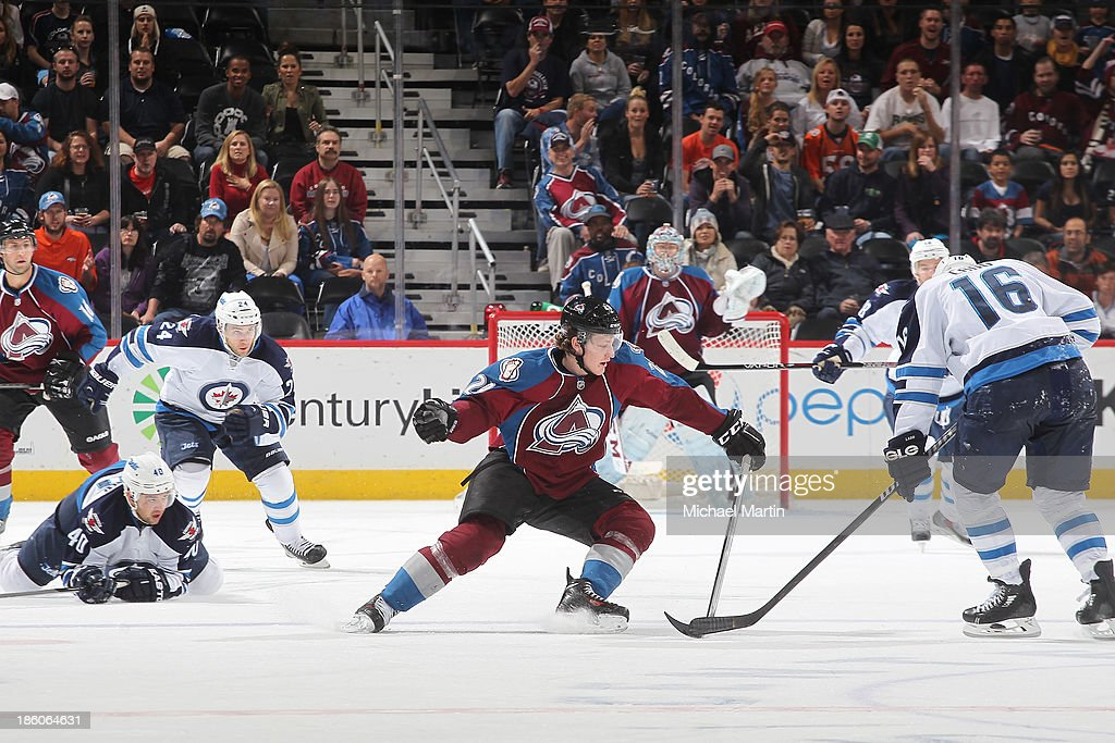 <a gi-track='captionPersonalityLinkClicked' href=/galleries/search?phrase=Nathan+MacKinnon&family=editorial&specificpeople=8610127 ng-click='$event.stopPropagation()'>Nathan MacKinnon</a> #29 of the Colorado Avalanche tries to get the puck away from <a gi-track='captionPersonalityLinkClicked' href=/galleries/search?phrase=Andrew+Ladd&family=editorial&specificpeople=228452 ng-click='$event.stopPropagation()'>Andrew Ladd</a> #16 of the Winnipeg Jets at the Pepsi Center on October 27, 2013 in Denver, Colorado. The Avalanche defeated the Jets 3-2.