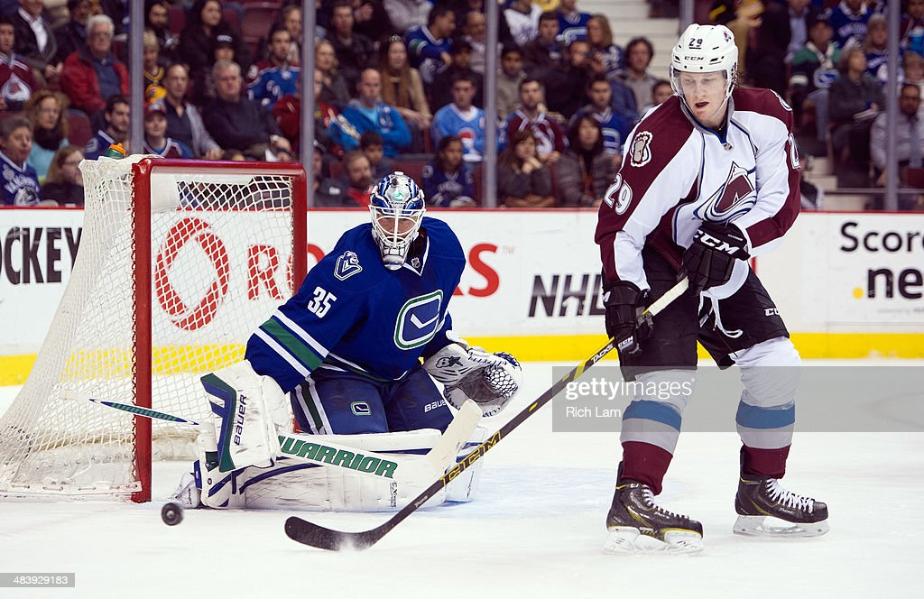 Nathan MacKinnon #29 of the Colorado Avalanche tries to redirect a shot onto goalie Jacob Markstrom #35 of the Vancouver Canucks during the first period in NHL action on April 10, 2014 at Rogers Arena in Vancouver, British Columbia, Canada.
