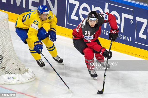 Nathan MacKinnon vies with Jonas Brodin during the Ice Hockey World Championship Gold medal game between Canada and Sweden at Lanxess Arena in...