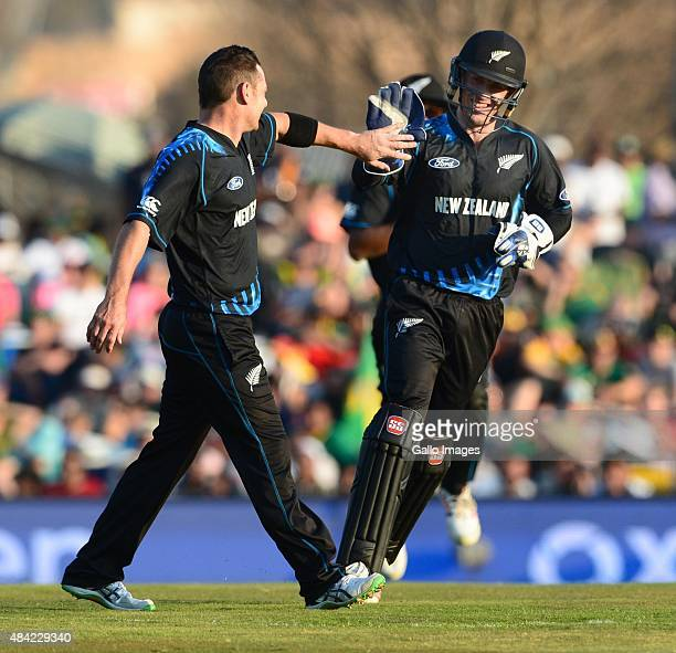 Nathan McCullum and Luke Ronchi of New Zealand celebrate the wicket of Farhaan Behardien of the Proteas during the 2nd KFC T20 International match...