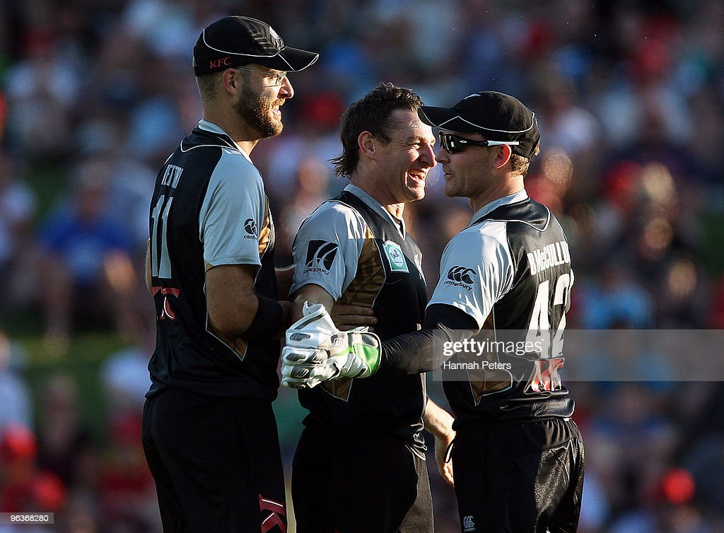 <a gi-track='captionPersonalityLinkClicked' href=/galleries/search?phrase=Nathan+McCullum&family=editorial&specificpeople=884481 ng-click='$event.stopPropagation()'>Nathan McCullum</a> celebrates with <a gi-track='captionPersonalityLinkClicked' href=/galleries/search?phrase=Daniel+Vettori&family=editorial&specificpeople=176492 ng-click='$event.stopPropagation()'>Daniel Vettori</a> and <a gi-track='captionPersonalityLinkClicked' href=/galleries/search?phrase=Brendon+McCullum&family=editorial&specificpeople=208154 ng-click='$event.stopPropagation()'>Brendon McCullum</a> of New Zealand after bowling Shakib Al HasanÊof Bangladesh out during the Twenty20 International match between New Zealand and Bangladesh at Seddon Park on February 3, 2010 in Hamilton, New Zealand.