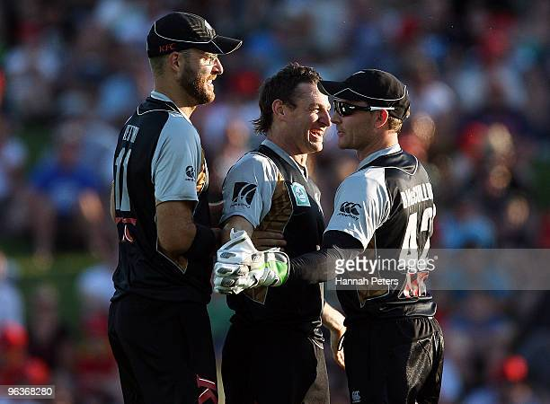 Nathan McCullum celebrates with Daniel Vettori and Brendon McCullum of New Zealand after bowling Shakib Al HasanÊof Bangladesh out during the...